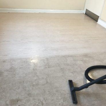 , Hard floor cleaning in progress