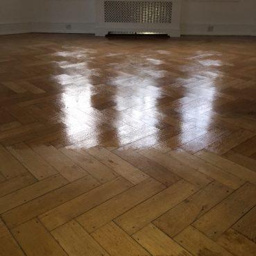 , Wooden floor cleaning in progress
